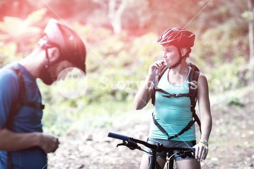 Female athletic drinking water from hydration pack