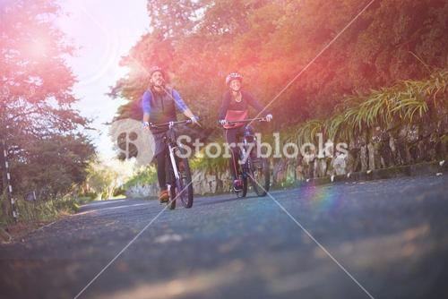Biker couple cycling on countryside road