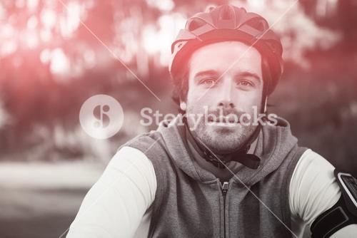 Portrait of male mountain biker riding bicycle in forest