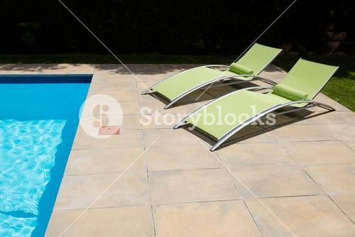 Two empty sun lounger on poolside