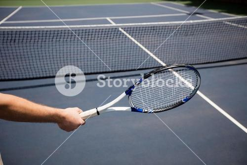 Hand of tennis player holding a racket
