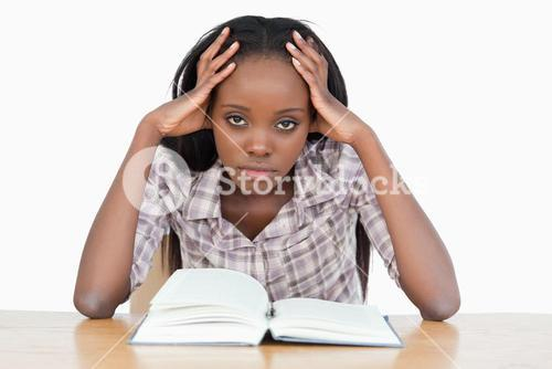 Bored student trying to read a book