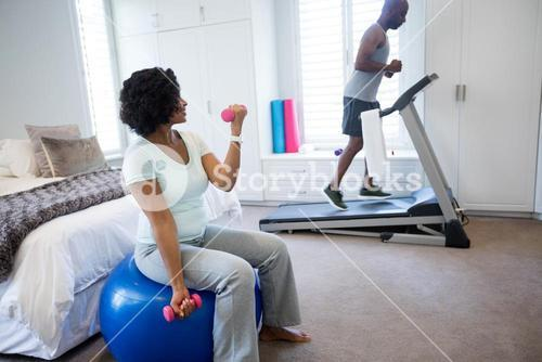 Man running on treadmill in bedroom