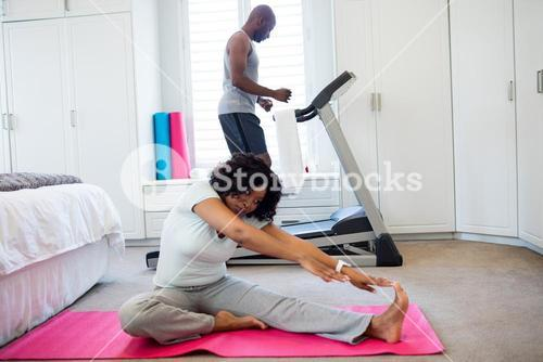 Couple exercising in bedroom