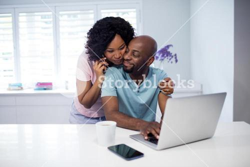 Romantic couple embracing in living room