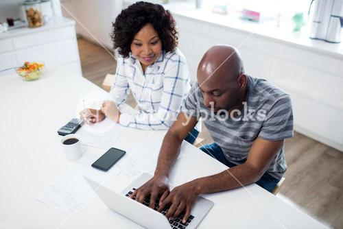 Couple checking bill in kitchen