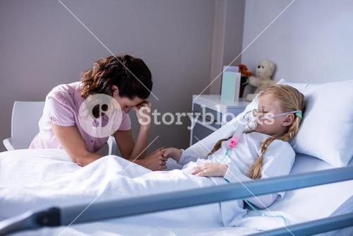 Sad doctor sitting with patient