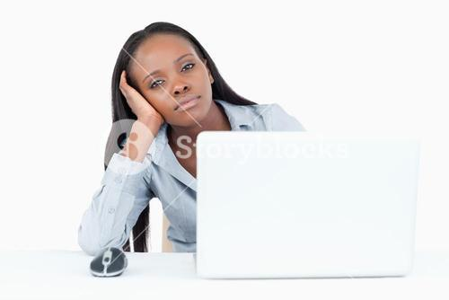 Bored businesswoman using a laptop