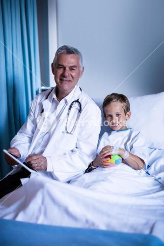 Doctor showing medical report in digital tablet to patient in hospital