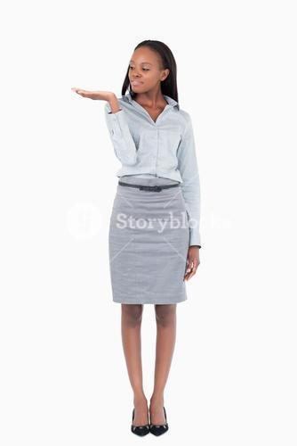 Portrait of a businesswoman displaying something