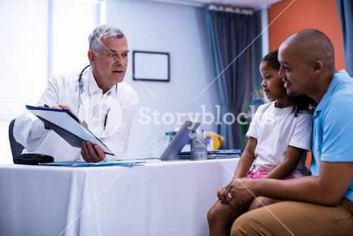 Doctor discussing report with patient