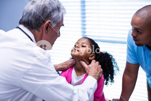 Doctor examining patients neck