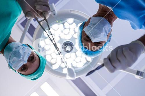 Surgeons performing operation in operation theater