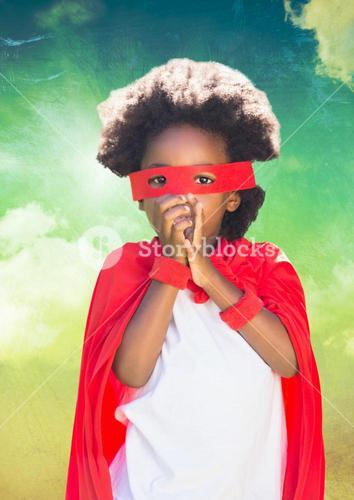 Superhero kid with red cape and eye mask