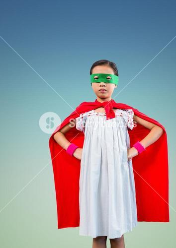 Superhero kid in red cape and green eye mask