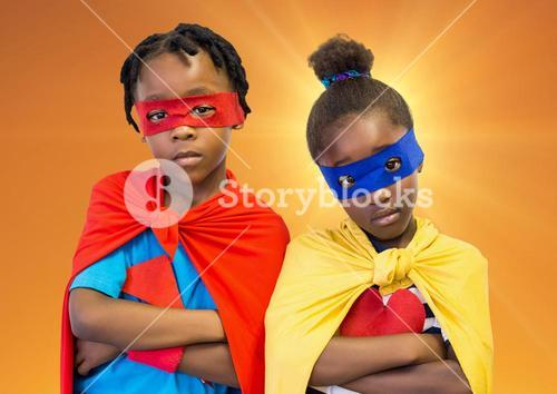 Superhero kids with red and yellow capes