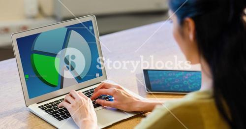Woman working on pie chart using laptop