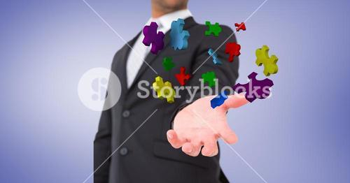 Businessman catching jigsaw puzzle pieces