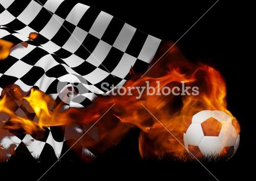 Checkered flag and soccer ball with flames against black background