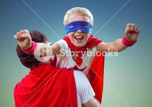 Father carrying a son in super hero costume