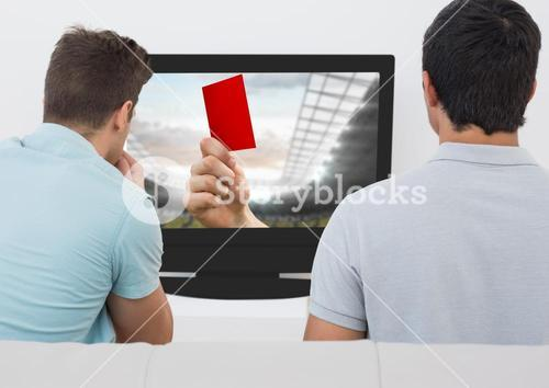 Friends watching soccer match on television