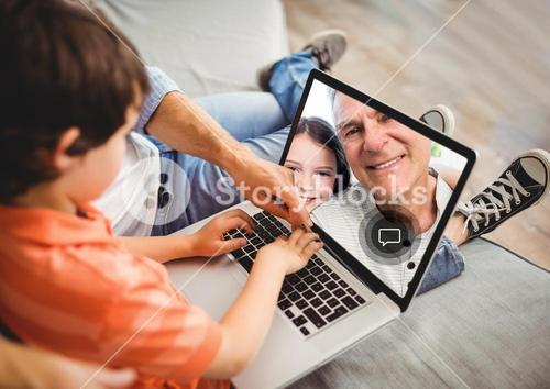 Boy having a video call with grandfather on laptop