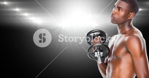 Healthy man working out with dumb bells