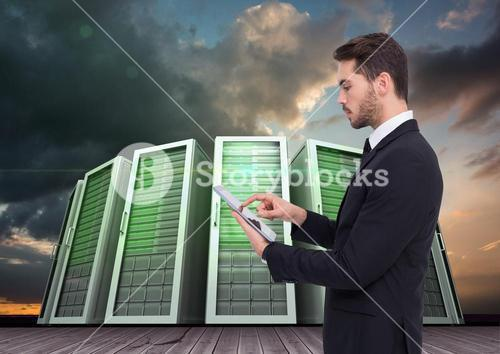 Businessman using digital tablet against server systems in sky