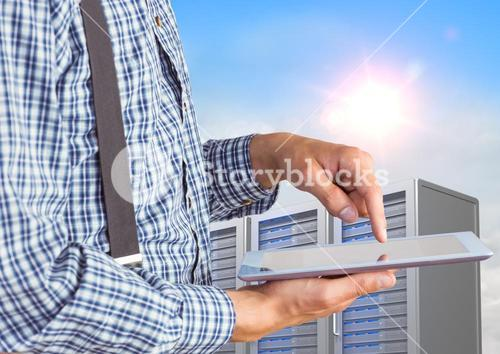 Man using digital tablet against office building in background