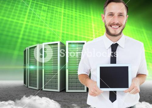 Man holding digital tablet against data center in background