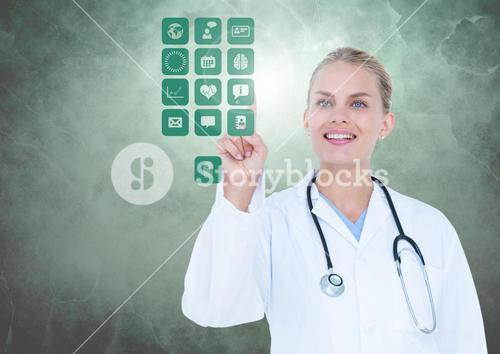 Doctor touching digitally generated medical icons against white background