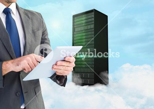 Businessman using digital tablet against background with server building in sky