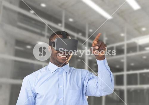 Man using virtual reality headset against office in background