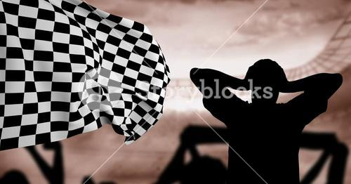 Silhouette of disappointed fan against checkered flag in background