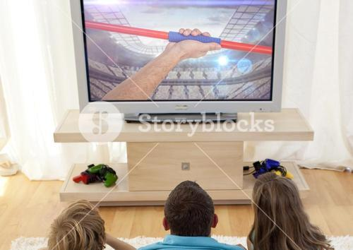 Family watching javelin throw on television at home