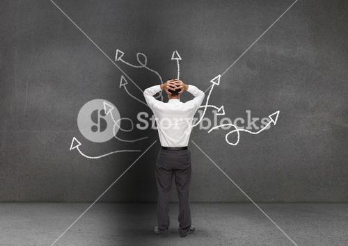 Frustrated business professional looking at the blackboard