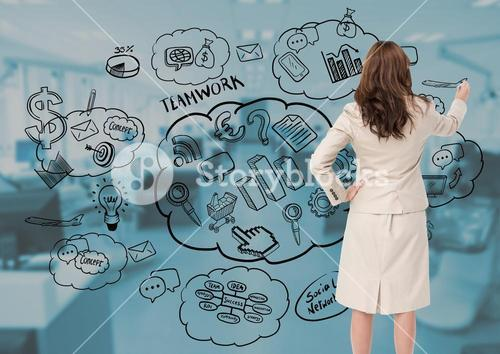 Businesswoman drawing business plan concept against office in background