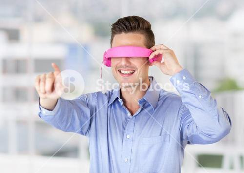 Man using virtual reality glasses against office window in background