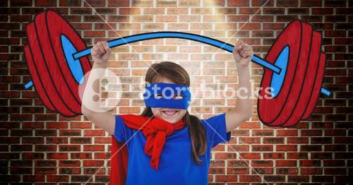 Girl in superhero costume pretending to lift weights against wooden background