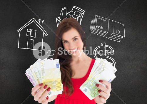 Woman holding euro cash against blackboard in background