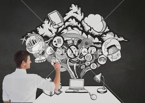Man drawing digital concepts on blackboard