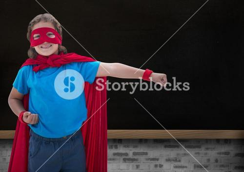 Portrait of smiling super kid in red cape and red mask