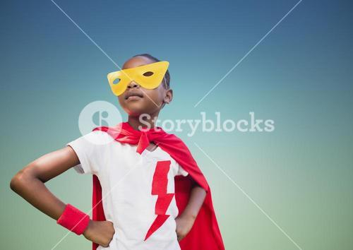 Super kid in red cape and yellow mask standing with hand on hip