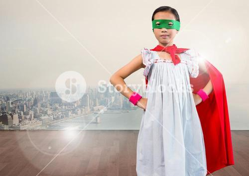 Portrait of super kid in red cape and green mask standing with hand on hip