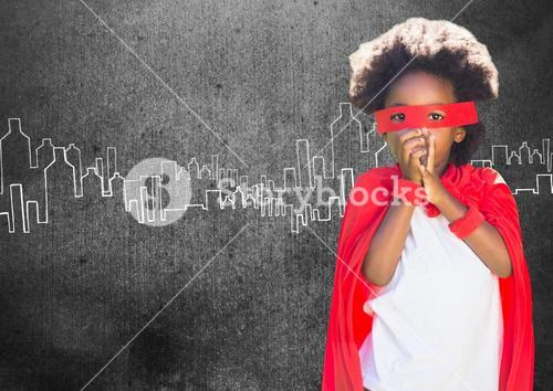 Portrait of super kid in red cape and red mask