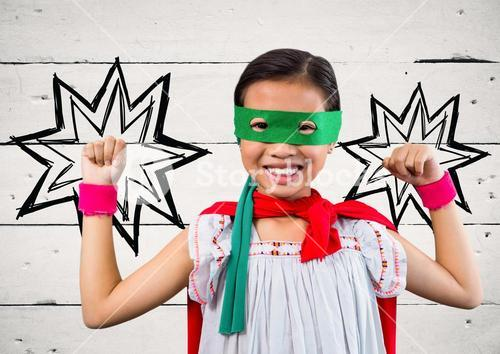 Portrait of kid in red cape and green mask standing with fist