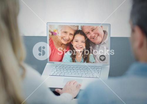 Couple having video chat on laptop
