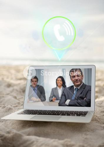 Laptop with video calling screen kept on sand at beach