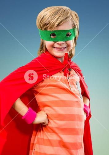 Portrait of smiling super kid in red cape and green mask