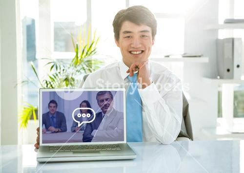 Portrait of smiling businessman showing laptop with video calling screen